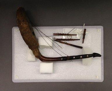 Mangbetu. <em>Harp (Kundi)</em>, early 20th century. Wood, snakeskin, fiber, 9 x 3 1/2 x 16 in. (22.9 x 8.9 x 40.6 cm). Brooklyn Museum, Museum Expedition 1931, Robert B. Woodward Memorial Fund, 31.1808a-e. Creative Commons-BY (Photo: Brooklyn Museum, CUR.31.1808a-e.jpg)