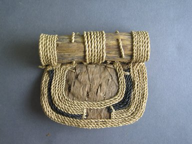 Mangbetu. <em>Woman's Bustle (Negbe) and Front Piece (Nogimwu)</em>, early 20th century. Banana leaf, raffia, a - 9 3/4 x 12 7/8 in. (24.8 x 32.7 cm). Brooklyn Museum, Museum Expedition 1931, Robert B. Woodward Memorial Fund, 31.1829a-b. Creative Commons-BY (Photo: Brooklyn Museum, CUR.31.1829b_front.jpg)