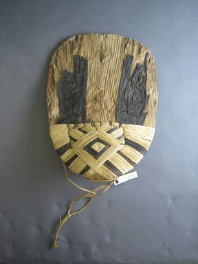 Mangbetu. <em>Woman's Bustle (Negbe)</em>, early 20th century. Banana leaf, raffia, metal, 10 x 7 5/16 in. (25.4 x 18.6 cm). Brooklyn Museum, Museum Expedition 1931, Robert B. Woodward Memorial Fund, 31.1834. Creative Commons-BY (Photo: Brooklyn Museum, CUR.31.1834_front.jpg)