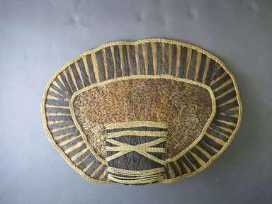 Mangbetu. <em>Woman's Bustle (Negbe) and Front Piece (Nogimwu)</em>, early 20th century. Banana leaf, raffia, Bustle (a): 9 1/4 x 13 1/4 in. (23.5 x 33.7 cm). Brooklyn Museum, Museum Expedition 1931, Robert B. Woodward Memorial Fund, 31.1836a-b. Creative Commons-BY (Photo: Brooklyn Museum, CUR.31.1836a_front.jpg)