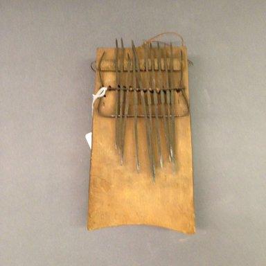 Possibly Mangbetu. <em>Plucked Idiophone (Sanza)</em>, early 20th century. Wood, metal, rattan, fiber, 5 1/2 x 9 5/8 in. (14 x 24.4 cm). Brooklyn Museum, Museum Expedition 1931, Robert B. Woodward Memorial Fund, 31.1844. Creative Commons-BY (Photo: Brooklyn Museum, CUR.31.1844.jpg)