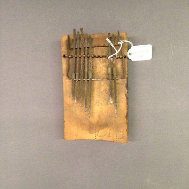 Mangbetu ?. <em>Plucked Idiophone (Sanza)</em>, early 20th century. Wood, metal, 1 5/8 x 6 1/2 x 3 5/8 in. (4.8 x 16.5 x 9.8 cm). Brooklyn Museum, Museum Expedition 1931, Robert B. Woodward Memorial Fund, 31.1857. Creative Commons-BY (Photo: Brooklyn Museum, CUR.31.1857.jpg)