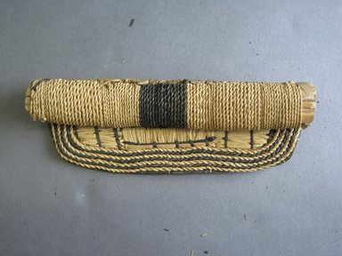 Mangbetu. <em>Woman's Bustle (Negbe) and Front Piece (Nogimwu)</em>, early 20th century. Banana leaf, raffia, a- 9 1/4 x 13 1/2 in. (23.5 x 34.3 cm). Brooklyn Museum, Museum Expedition 1931, Robert B. Woodward Memorial Fund, 31.1867a-b. Creative Commons-BY (Photo: Brooklyn Museum, CUR.31.1867b_front.jpg)