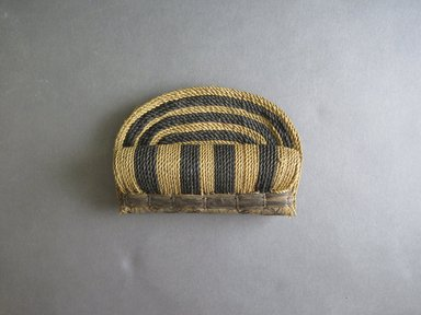 Mangbetu. <em>Front Piece (Nogetwe) for Woman's Bustle (Negbe)</em>, early 20th century. Banana leaf, 3 3/4 x 5 1/4 in. (9.5 x 13.3 cm). Brooklyn Museum, Museum Expedition 1931, Robert B. Woodward Memorial Fund, 31.1871. Creative Commons-BY (Photo: Brooklyn Museum, CUR.31.1871_front.jpg)