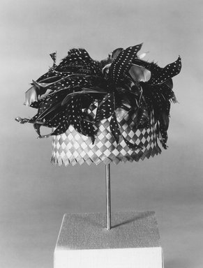 Mangbetu. <em>Hat</em>, early 20th century. Palm fiber, 3 x 7 7/8 in.  (7.6 x 20.0 cm). Brooklyn Museum, Museum Expedition 1931, Robert B. Woodward Memorial Fund, 31.1883. Creative Commons-BY (Photo: Brooklyn Museum, CUR.31.1883_print_bw.jpg)
