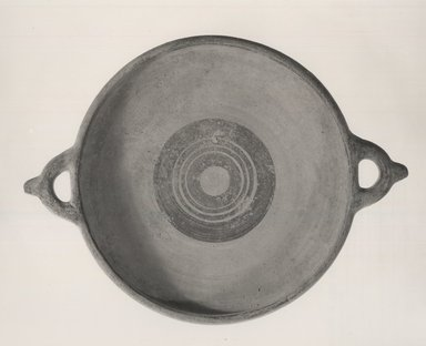 Cypriot. <em>Plate</em>, 950-850 B.C.E. Terracotta, pigment, 1 15/16 x Diam. with handles 13 3/4 in. (5 x 35 cm). Brooklyn Museum, Charles Edwin Wilbour Fund, 32.1716.1. Creative Commons-BY (Photo: Brooklyn Museum, CUR.32.1716.1_NegA_print_bw.jpg)