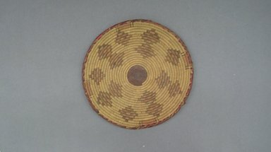 <em>Round Basketry Lid</em>, early 20th century. Fiber, leather, height: (1.5 cm). Brooklyn Museum, Gift of Theodora Wilbour, 32.1762. Creative Commons-BY (Photo: Brooklyn Museum, CUR.32.1762_top.jpg)