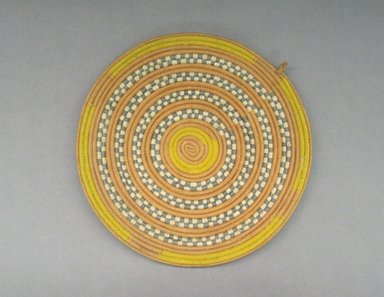 <em>Lid for Calabash Bowl</em>, early 20th century. Vegetable fiber, cotton thread, height: (2.4 cm). Brooklyn Museum, Gift of Theodora Wilbour, 32.1767. Creative Commons-BY (Photo: Brooklyn Museum, CUR.32.1767_top.jpg)