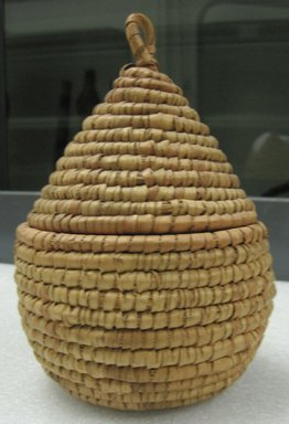 <em>Cone Shaped Basket with Cover</em>. Fiber, cane, raffia, height (incl. loop): 7 1/2 in. Brooklyn Museum, Gift of Theodora Wilbour, 32.1770a-b. Creative Commons-BY (Photo: Brooklyn Museum, CUR.32.1770a-b_side.jpg)