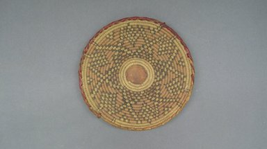 <em>Basketry Lid</em>, early 20th century. Vegetal fiber, leather, raffia, reed, diam.: 8 1/2 in. Brooklyn Museum, Gift of Theodora Wilbour, 32.1773. Creative Commons-BY (Photo: Brooklyn Museum, CUR.32.1773_top.jpg)