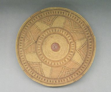 <em>Basketry Lid</em>, early 20th century. Vegetal fiber, leather, raffia, reed, height: 2 1/2 in. Brooklyn Museum, Gift of Theodora Wilbour, 32.1774. Creative Commons-BY (Photo: Brooklyn Museum, CUR.32.1774_top.jpg)