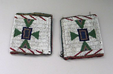 Blackfoot. <em>Pair of Beaded Cuffs</em>. Beads, buckskin, a: 5 x 10 in. (12.7 x 25.4 cm). Brooklyn Museum, Bequest of W.S. Morton Mead, 32.2099.32546a-b. Creative Commons-BY (Photo: Brooklyn Museum, CUR.32.2099.32546a-b_view1.jpg)