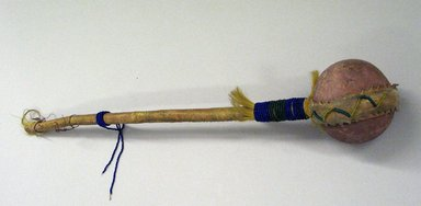Blackfoot. <em>War Club</em>, 19th century. Stone, wood, hide, beads, 25 in. with stone hammer 4 in. (63.5 x 10.2 cm). Brooklyn Museum, Bequest of W.S. Morton Mead, 32.2099.32569. Creative Commons-BY (Photo: Brooklyn Museum, CUR.32.2099.32569_view1.jpg)