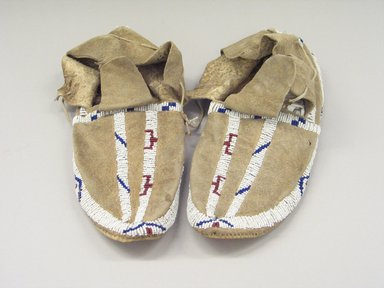 Blackfoot. <em>Pair of Beaded Moccasins</em>. Beads, buckskin Brooklyn Museum, Bequest of W.S. Morton Mead, 32.2099.32573a-b. Creative Commons-BY (Photo: Brooklyn Museum, CUR.32.2099.32573a-b.jpg)