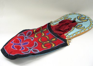 Blackfoot. <em>Beaded Cradleboard</em>, 20th century. Beads, cotton, wool, silk, felt, metal, 34 5/8 x 13 3/8 in. (87.9 x 34 cm). Brooklyn Museum, Bequest of W.S. Morton Mead, 32.2099.32581. Creative Commons-BY (Photo: Brooklyn Museum, CUR.32.2099.32581_view1.jpg)