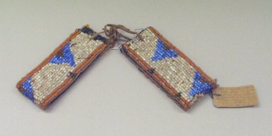 Blackfoot. <em>Pair of Beaded Arm Bands</em>, 1900-1930. Beads, canvas, cotton Brooklyn Museum, Bequest of W.S. Morton Mead, 32.2099.32582a-b. Creative Commons-BY (Photo: Brooklyn Museum, CUR.32.2099.32582a-b_view1.jpg)