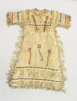Possibly Apache. <em>Fringed and Beaded Dress</em>, early 20th century. Buckskin, beads Brooklyn Museum, Bequest of W.S. Morton Mead, 32.2099.32583. Creative Commons-BY (Photo: Brooklyn Museum, CUR.32.2099.32583_view1.jpg)