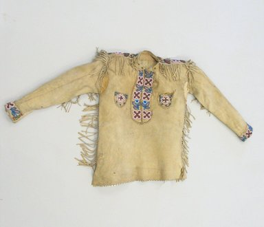 Possibly Blackfoot or. <em>Shirt</em>, ca. 1900. Buckskin, glass beads, sinew Brooklyn Museum, Bequest of W.S. Morton Mead, 32.2099.32584. Creative Commons-BY (Photo: Brooklyn Museum, CUR.32.2099.32584_view1.jpg)