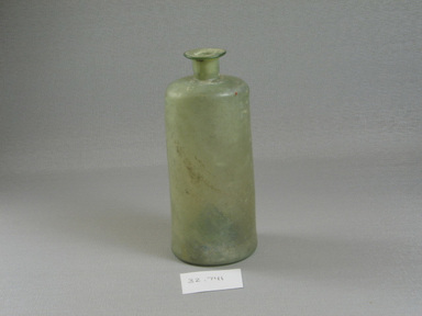 Roman. <em>Bottle</em>, 1st-5th century C.E. Glass, 5 7/16 x Diam. 2 3/8 in. (13.8 x 6 cm). Brooklyn Museum, Gift of the executors of the Estate of Colonel Michael Friedsam, 32.741. Creative Commons-BY (Photo: Brooklyn Museum, CUR.32.741_view1.jpg)