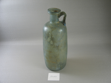 Roman. <em>Bottle with Incised Line Decoration</em>, 2nd-early 3rd century C.E. Glass, 8 1/16 x greatest diam. 3 1/8 in. (20.4 x 7.9 cm). Brooklyn Museum, Frederick Loeser Fund, 33.401. Creative Commons-BY (Photo: Brooklyn Museum, CUR.33.401_view1.jpg)