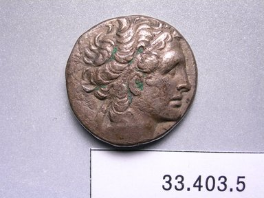 Greek. <em>Tetradrachm of Ptolemy XIII</em>. Silver, 3/16 x 1 in. (0.4 x 2.5 cm). Brooklyn Museum, Frederick Loeser Fund, 33.403.5. Creative Commons-BY (Photo: Brooklyn Museum, CUR.33.403.5_heads.jpg)
