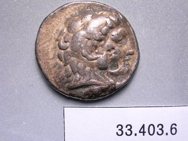 Greek. <em>Tetradrachm of Alexander the Great</em>, ca. 332-321 B.C.E. (possibly). Silver, 3/16 x 1 in. (0.4 x 2.6 cm). Brooklyn Museum, Frederick Loeser Fund, 33.403.6. Creative Commons-BY (Photo: Brooklyn Museum, CUR.33.403.6_heads.jpg)