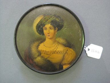 <em>Snuff Box</em>, ca. 1825. Black lacquered papier mache, Diam: 3/4 x 3 5/8 in. (1.9 x 9.2 cm). Brooklyn Museum, Gift of Mrs. Clarence A. Martin, 33.412. Creative Commons-BY (Photo: Brooklyn Museum, CUR.33.412.jpg)