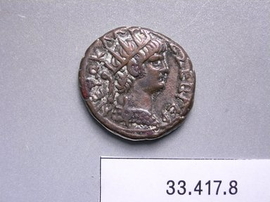 Greek or Roman. <em>Coin: Tetradrachm of Nero</em>, 54-68 C.E. Billon, 1/8 x 7/8 in. (0.3 x 2.3 cm). Brooklyn Museum, Charles Edwin Wilbour Fund, 33.417.8. Creative Commons-BY (Photo: Brooklyn Museum, CUR.33.417.8_heads.jpg)