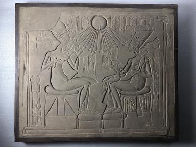 <em>Cast of a Relief of Akhenaten, Nefertiti, and Princesses</em>, ca. 1933 C.E. Plaster, pigment, 14 5/16 x 16 3/4 x 1 5/16 in. (36.3 x 42.5 x 3.3 cm). Brooklyn Museum, 33.513. Creative Commons-BY (Photo: , CUR.33.513_view01.jpg)
