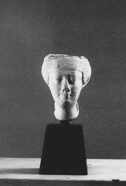 <em>Model of a Woman's Head</em>, 332-30 B.C.E. Plaster, 3 3/8 × 2 1/2 in. (8.6 × 6.4 cm). Brooklyn Museum, Charles Edwin Wilbour Fund, 33.592. Creative Commons-BY (Photo: Brooklyn Museum, CUR.33.592_NegB_print.bw.jpg)