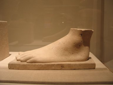 <em>Model or Temple Offering of a Foot</em>, ca. 664-30 B.C.E. Limestone, 3 15/16 x 2 1/2 x 8 3/4 in. (10 x 6.4 x 22.3 cm). Brooklyn Museum, Charles Edwin Wilbour Fund, 34.1001. Creative Commons-BY (Photo: Brooklyn Museum, CUR.34.1001_wwg8.jpg)