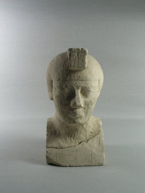<em>Sculptor's Model of a Head of a King</em>, 3rd-1st century B.C.E. Limestone, 6 3/4 × 3 7/8 × 3 11/16 in. (17.2 × 9.9 × 9.3 cm). Brooklyn Museum, Charles Edwin Wilbour Fund, 34.1005. Creative Commons-BY (Photo: , CUR.34.1005_view01.jpg)
