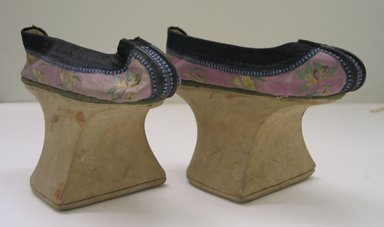 <em>Pair of  Woman's Shoes</em>. Wood, silk, leather, 5 1/2 x 8 3/4 x 3 1/4 in.  (14.0 x 22.2 x 8.3 cm). Brooklyn Museum, Brooklyn Museum Collection, 34.1020a-b. Creative Commons-BY (Photo: Brooklyn Museum, CUR.34.1020a-b_view1.jpg)