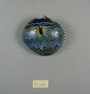 <em>Fragment of a Small Vase</em>, ca. 1352-1332 B.C.E. Glass, 2 11/16 x 2 15/16 in. (6.8 x 7.4 cm). Brooklyn Museum, Charles Edwin Wilbour Fund, 34.1184. Creative Commons-BY (Photo: Brooklyn Museum, CUR.34.1184_view5.jpg)