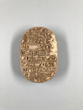 <em>Large Scarab of Amenhotep III</em>, ca. 1390-1352 B.C.E. Steatite, glaze, 11/16 x 2 1/4 x 3 3/8 in. (1.8 x 5.7 x 8.6 cm). Brooklyn Museum, Charles Edwin Wilbour Fund, 34.1185. Creative Commons-BY (Photo: , CUR.34.1185_view01.jpg)
