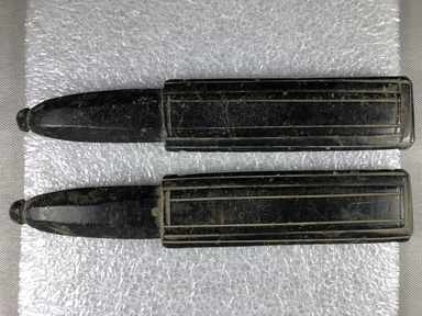 <em>Double Mold for Making Metal Beads</em>, 30 B.C.E.-395 C.E., or later. Basalt (?), 34.1187a: 5/8 × 1 9/16 × 8 9/16 in. (1.6 × 4 × 21.7 cm). Brooklyn Museum, Charles Edwin Wilbour Fund, 34.1187a-b. Creative Commons-BY (Photo: , CUR.34.1187a-b_view02.jpg)