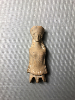 Greek. <em>Female Doll</em>, late 6th century B.C.E. Clay, pigment, 3 3/16 × 1 3/16 × 9/16 in. (8.1 × 3 × 1.5 cm). Brooklyn Museum, Charles Edwin Wilbour Fund, 34.1209. Creative Commons-BY (Photo: , CUR.34.1209_view01.jpg)