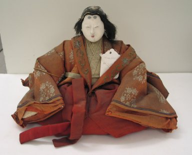 <em>Princess Doll (Ohinamasa)</em>. Silk, wood, porcelain, human hair, 9 x 12 x 6 1/2in. (22.9 x 30.5 x 16.5cm). Brooklyn Museum, Brooklyn Museum Collection, 34.1326. Creative Commons-BY (Photo: Brooklyn Museum, CUR.34.1326_view1.jpg)