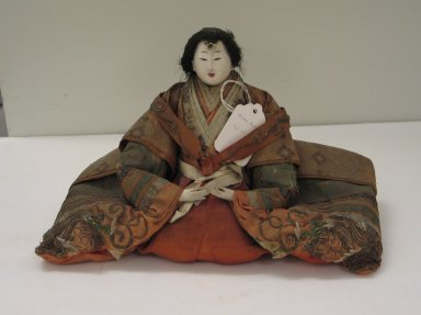 <em>Princess Doll (Ohinasama)</em>. Silk, wood, porcelain, human hair, 7 x 11 1/2 x 6 1/2in. (17.8 x 29.2 x 16.5cm). Brooklyn Museum, Brooklyn Museum Collection, 34.1329. Creative Commons-BY (Photo: Brooklyn Museum, CUR.34.1329_view1.jpg)