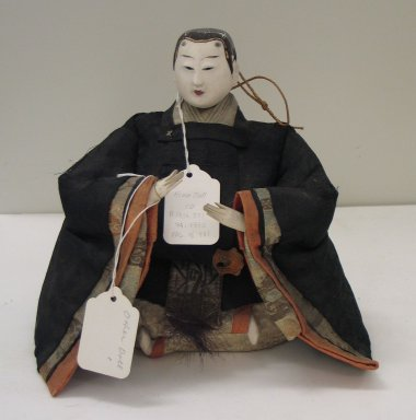 <em>Doll Depicting Male Courtier</em>. Silk, wood, human hair, porcelain, 8 1/2 x 9 1/4 x 5 1/2 in. Brooklyn Museum, Brooklyn Museum Collection, 34.1330. Creative Commons-BY (Photo: Brooklyn Museum, CUR.34.1330_view1.jpg)