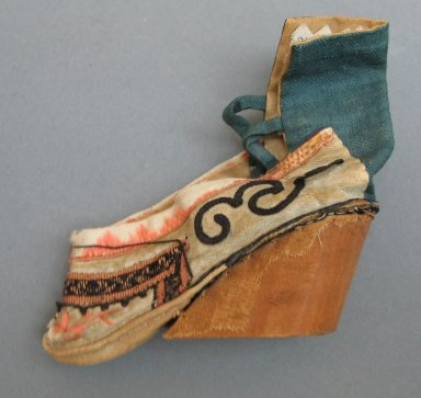 <em>Tiny Shoe for Woman's Bound Foot</em>, 19th century. Wood, plain linen, fancy silk, satin silk, 3 9/16 x 3 9/16 in. (9 x 9 cm). Brooklyn Museum, Brooklyn Museum Collection, 34.1379. Creative Commons-BY (Photo: Brooklyn Museum, CUR.34.1379_view1.jpg)