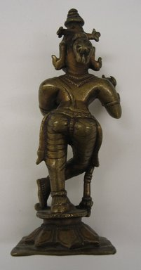 <em>Small Figure of Kirsna Bamsidhara</em>, 18th-19th century. Brass, 5 x 1 15/16 in. (12.7 x 5 cm). Brooklyn Museum, Brooklyn Museum Collection, 34.147. Creative Commons-BY (Photo: Brooklyn Museum, CUR.34.147_back.jpg)
