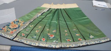 <em>Woman's Skirt</em>. Embroidered satin silk, green skirt: 48 1/16 x 38 9/16 in. (122 x 98 cm). Brooklyn Museum, Brooklyn Museum Collection, 34.1481. Creative Commons-BY (Photo: Brooklyn Museum, CUR.34.1481_component1.jpg)