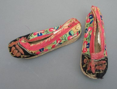 <em>Pair of Manchu Child's Shoes</em>, early 20th century. Leather, embroidered satin silk, Pair: 2 3/8 x 5 7/8 in. (6 x 15 cm). Brooklyn Museum, Brooklyn Museum Collection, 34.1484. Creative Commons-BY (Photo: Brooklyn Museum, CUR.34.1484_view1.jpg)