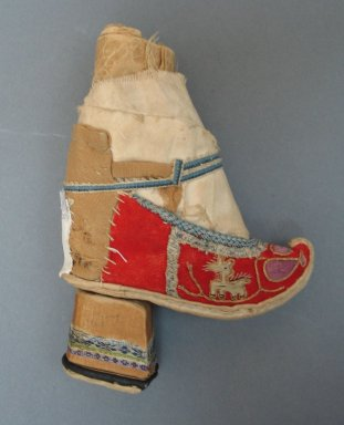 <em>Toy Shoe and Ankle Band for a Woman's Bound Foot</em>, 19th century. Wood, cloth cotton, 5 1/8 x 3 15/16 in. (13 x 10 cm). Brooklyn Museum, Brooklyn Museum Collection, 34.1500. Creative Commons-BY (Photo: Brooklyn Museum, CUR.34.1500_view1.jpg)