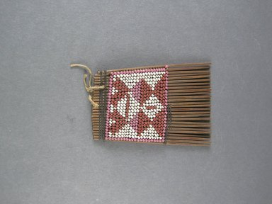 <em>Comb</em>. Seed and bead work, 1 3/4 x 13 3/8 in. (4.5 x 34 cm). Brooklyn Museum, Gift of Dr. Clark Burnham, 34.5603.23. Creative Commons-BY (Photo: Brooklyn Museum, CUR.34.5603.23_top.jpg)