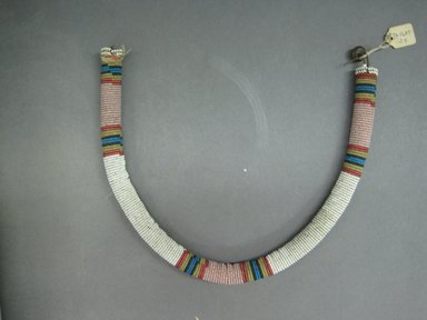 Zulu. <em>Neck or Body Ornament</em>, late 19th century. Glass beads, natural fiber, leather, 18 3/4 x 5/8 in. (47.6 x 1.6 cm). Brooklyn Museum, Gift of Dr. Clark Burnham, 34.5603.24. Creative Commons-BY (Photo: Brooklyn Museum, CUR.34.5603.24_overall.jpg)