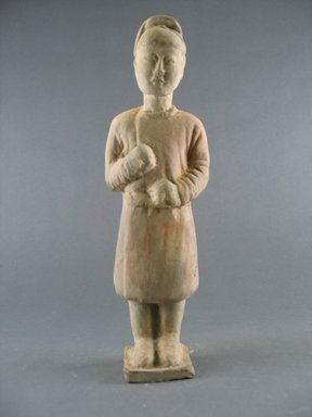<em>Tomb Figure of an Attendant</em>, 618-906. Earthenware, 9 3/8 in. (23.8 cm). Brooklyn Museum, Brooklyn Museum Collection, 34.5619. Creative Commons-BY (Photo: Brooklyn Museum, CUR.34.5619_front.jpg)