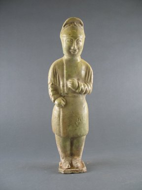 <em>Tomb Figure of an Attendant</em>, 581-618. Earthenware with lead glaze, 10 3/4 in. (27.3 cm). Brooklyn Museum, Brooklyn Museum Collection, 34.5642. Creative Commons-BY (Photo: Brooklyn Museum, CUR.34.5642._front.jpg)