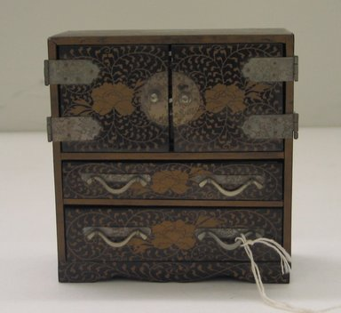 <em>Small Tansu Chest</em>. Wood, lacquer, metal, 4 1/2 x 4 1/4 x 1 7/8 in. Brooklyn Museum, Brooklyn Museum Collection, 34.5785. Creative Commons-BY (Photo: Brooklyn Museum, CUR.34.5785_view1.jpg)